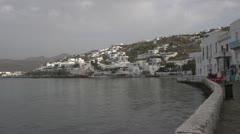 Greek village seaside, with seawall, wide shot late morning Stock Footage