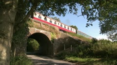 Steam Engine Passing over Bridge at the Bluebell Railway Stock Footage