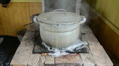 Big pot boil water run flow burn rural on old rural furnace Stock Footage