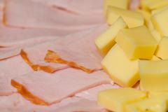 Sliced meat appetizers and cheese in plate Stock Photos