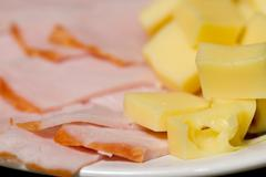 sliced meat appetizers and cheese in plate - stock photo