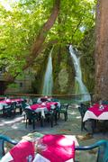 Summer restaurant with a waterfall Stock Photos