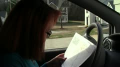 Studying Map, Buckling Up Stock Footage