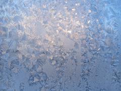 ice pattern on winter glass - stock photo