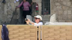 Tourist Woman Photograph at the Western Wall Stock Footage