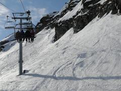 ski lift and skiers .. - stock photo