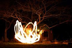 Fire Juggler - stock photo
