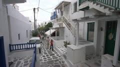 Tourists wander in Greek village, Stock Footage