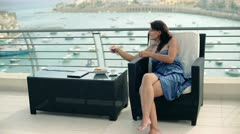 Happy woman talking on cellphone on the terrace Stock Footage