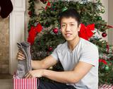Stock Photo of young man with holiday gifts