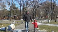 Father Walking with his Child in Park Stock Footage