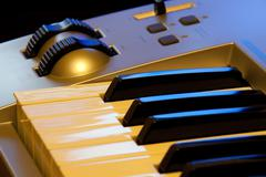 Synthesizer keyboard and controls - stock photo