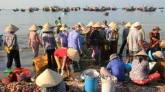 Vietnam fishing village. Women, men and kids, hard at work3 Stock Footage