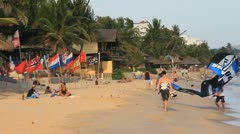 Vietnam beach in Mui Ne. Getting ready to Kite surf - stock footage