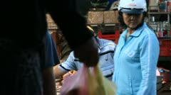Vietnam street market. People selling and buying all types of goods. Stock Footage