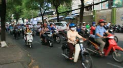 Vietnam traffic filled with motorbikes, Taxi's and cars - stock footage