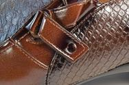 Glossy brown shoe detail Stock Photos