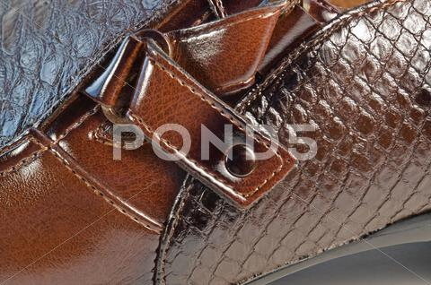 Stock photo of glossy brown shoe detail
