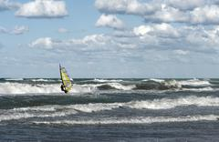 Windsurfer in wavy sea Stock Photos