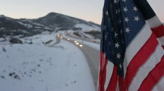 American flag over the freeway. Stock Footage