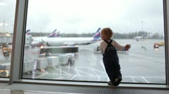 Kid near the window in the airport. Stock Footage
