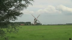 Netherlands lush meadow and triangular windmill zoom in 2 Stock Footage
