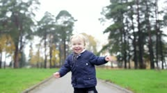 A little two year old boy is walking. Slow motion 50fr/sec Stock Footage