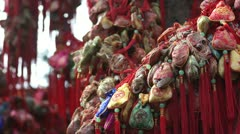 China, hang in a tree the mascots sachets, pray for peace and happy Stock Footage