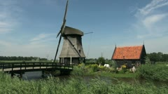 Netherlands Kinderdijk bridge leading to windmill and small windmill 19 Stock Footage