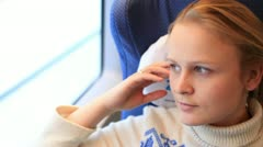 Young girl is travelling by a high-speed train. Stock Footage