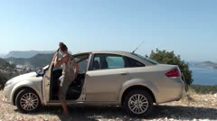 Woman gets in the car and puts on her sunglasses Stock Footage