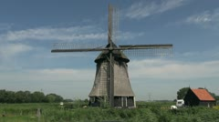 Netherlands Kinderdijk windmill with cross blades 18 Stock Footage