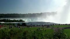 Tourist crowd & Spray mist cloud at Niagara Falls (Horseshoe) Stock Footage