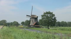 Netherlands Kinderdijk windmill near yellow car and red roof 17 Stock Footage