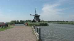 Netherlands Kinderdijk windmill and rails by path zoom 15 Stock Footage