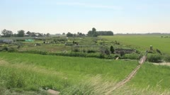 Netherlands bridge over ditch to garden 2 Stock Footage