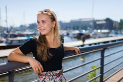 girl and city harbour - stock photo