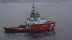 Maritime transportation, early dawn Istanbul tug boat Stock Footage