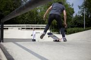 Stock Photo of Skateboard stunt on the ramp