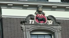 Netherlands Edam lion gargoyle and cow emblem Stock Footage