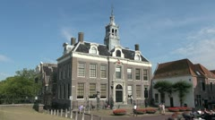 Netherlands Edam Town Hall and oval planters Stock Footage