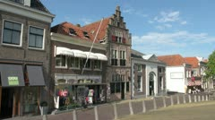 Netherlands Edam white awnings over storefront Stock Footage