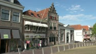Stock Video Footage of Netherlands Edam white awnings over storefront