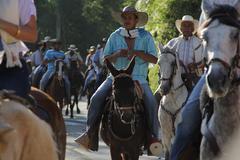 Latin American men riding Stock Photos
