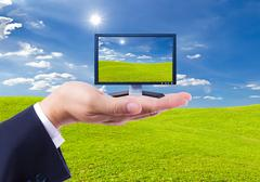 lcd monitor in hand isolated - stock photo