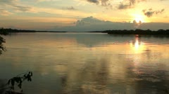 Sunset over a major tributary of the Amazon - the Rio Napo in Ecuador  Stock Footage