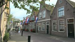 Netherlands Edam houses Dutch flags Stock Footage