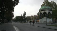 Sultan Ahmet Square Istanbul, framed by little dome cupola and trees Stock Footage
