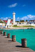 Old tilted and new lighthouses in puerto morelos near cancun, quintana roo, m Stock Photos