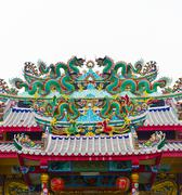 Dragon statue on chinese temple roof Stock Photos